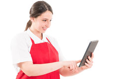 Modern supermarket employee using wireless tablet Stock Images