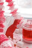 Modern surreal tea party with living coral color toy, sweetness, wonderland morning on windowsiil, unusual still life background