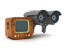 Modern surveillance camera and retro tv on white background Stock Image