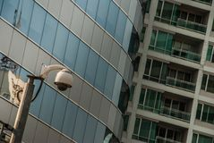 Modern surveillance cameras on the cityscape background wall stock image