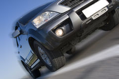 Modern SUV moving Royalty Free Stock Image