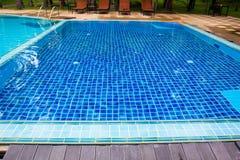Modern swimming pool decorate. Outdoor modern swimming pool decorate Stock Photo