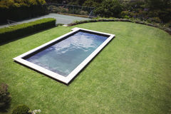 Modern swimming pool in lawn Royalty Free Stock Photography