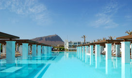 Modern swimming pool at luxury hotel. Crete, Greece Royalty Free Stock Photography