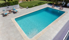 Modern swimming pool for tourists, in garden. stock photo