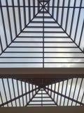 Modern symmetrical architecture. Urban building roof Stock Photos