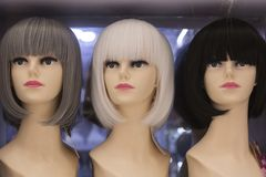 Modern synthetic wigs Royalty Free Stock Photos