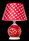 Modern table lamp isolated on black. Lamp for interior, red dotted design Stock Image