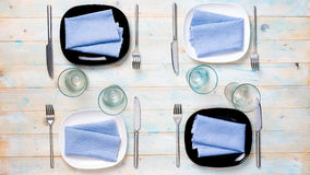 Modern table setting with plates, glasses and silverware Stock Image
