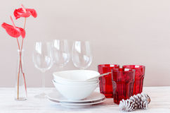 Modern table setting with red white theme, christmas holiday sea Royalty Free Stock Images