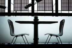 Modern table and two chairs Royalty Free Stock Photo
