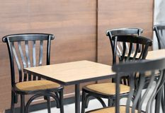 Modern tables and chairs in coffee shop or bekery store royalty free stock image