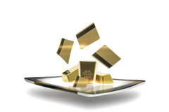 Modern tablet with gold bullion. Conceptual image of a modern portable computer tablet with gold bullion bars emitting from the surface of the screen Royalty Free Stock Photo