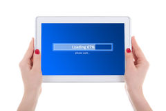 Modern tablet pc loading in female hands isolated on white Royalty Free Stock Image