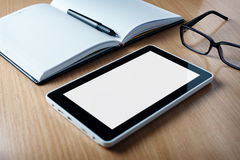 Modern tablet PC next to a classical open agenda Stock Images