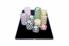Modern tablet with poker chips Stock Images