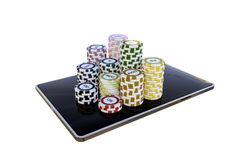 Modern tablet with poker chips Stock Photo