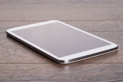Modern tablet on wooden table Royalty Free Stock Images