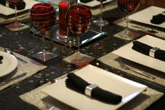 Modern tableware 3. Modern tableware setting. Shallow focus on red glasses Royalty Free Stock Photo