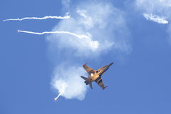 Modern tactical jet fighter shooting flares Stock Photos