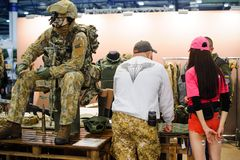 Modern tactical military equipment and weapons demonstrated at the exhibition Royalty Free Stock Images