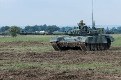 Modern tank on battle field aiming Stock Photography