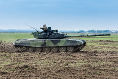 Modern tank on battle field at high speed Royalty Free Stock Photos
