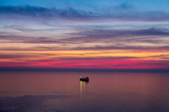 Modern tanker at sunset. Modern tanker in the ocean bay at sunset Royalty Free Stock Images