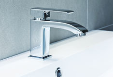 Modern tap. Modern ta in bathroom closeup image stock photos