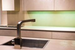 Modern Tap Faucet in Kitchen. Contemporary Stainless Steel Tap in Minimalist Kitchen Stock Image