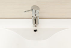 Modern tap and white sink. Stock Photography