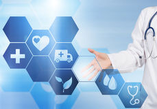 Modern technologies in medicine. Close up of female doctor touching icon of media screen Stock Photography