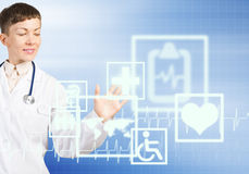 Modern technologies in medicine. Close up of female doctor touching icon of media screen Royalty Free Stock Photography