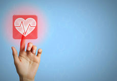 Modern technologies for medicine. Hand of person touching cardiology icon on screen Stock Photo