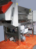 Modern technologies in production of food. The machine a crusher, a separator of crests - primary processing of grapes stock photo