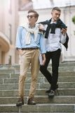 Modern technology communication. Happy men. Modern technology communication. Two happy men. Street hipster style, young males outdoors royalty free stock photo