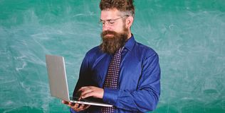 Modern technology education. Hipster teacher wear eyeglasses and necktie holds laptop. Digital technology education. Start lesson. Teacher bearded man with royalty free stock photos