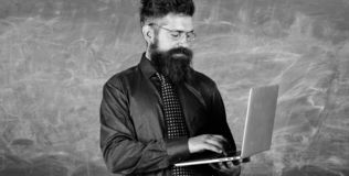 Modern technology education. Hipster teacher wear eyeglasses and necktie holds laptop. Digital technology education. Start lesson. Teacher bearded man with stock photography
