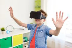 Boy in virtual reality headset or 3d glasses Stock Images