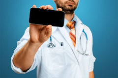 Modern Technology in Health and Medicine Concept. Doctor With Smartphone stock photo
