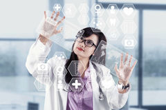 Modern technology in medical. Image of young woman doctor. Concept of modern technology Stock Photography
