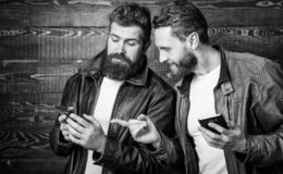 Modern technology. Men with smartphones surfing internet. Mobile internet. Business application. Men brutal bearded stock images