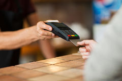 Hands with payment terminal and credit card Royalty Free Stock Photo