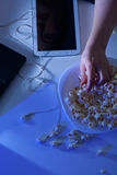 Modern technology and popcorn Stock Images