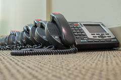 Modern Technology VoIP Telephones sit waiting their deployment Royalty Free Stock Images
