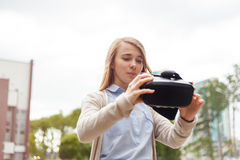 Modern technology vr headset in woman hands.  Stock Photos