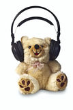 Modern teddy bear with headphones. Toy teddy bear with headphones on white background Royalty Free Stock Images