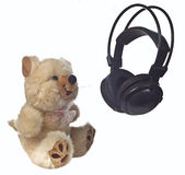 Modern teddy bear with headphones. Toy teddy bear with headphones on white background Royalty Free Stock Photo