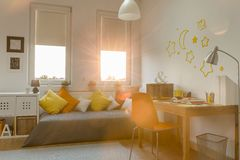 Modern teen room. Yellow and orange decorations in modern teen room Royalty Free Stock Photo
