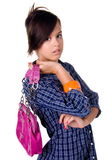 Modern Teenage Girl. Beautiful teenage girl in a casual blue shirt dress with a pink leather purse stock image